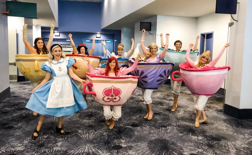 "D23 Expo Mousequerade costume contest ""Cast of Characters"" 2019 winner ""Mad Princess Party"" transformation teacup dresses"